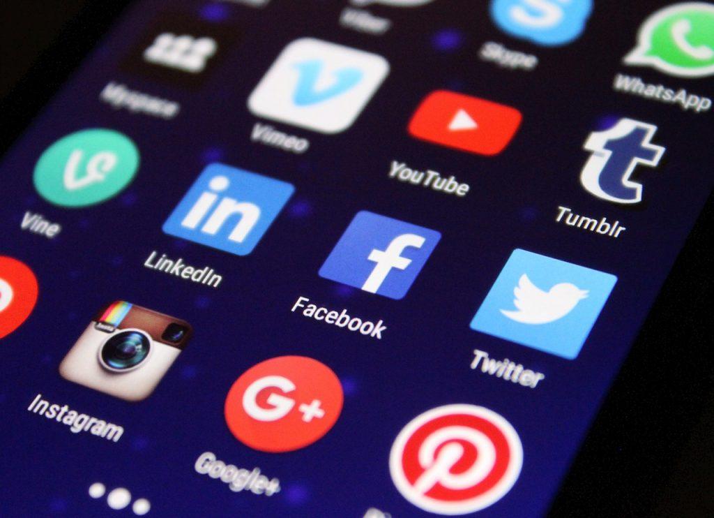 Social media app logos displayed on a phone screen