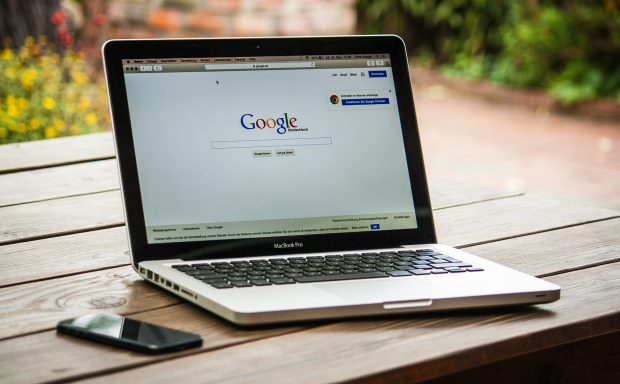 Laptop with the Google search engine on the screen